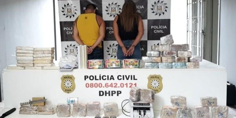 Casal é preso com R$ 700 mil e drogas